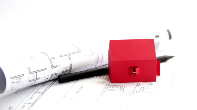 Red house over architecture plans