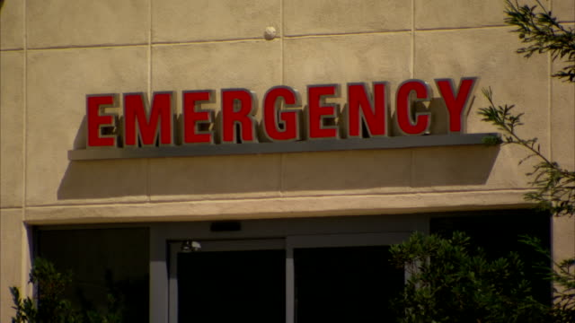WS Red letterings over entrance to unidentifiable building 'Emergency' Hospital medical center emergency room accident emergency department emergency...