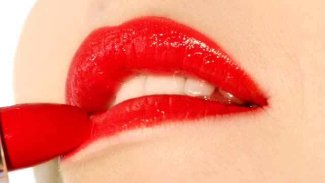 Red lips with lipstick.