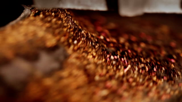 Red shavings on working industrial lathe