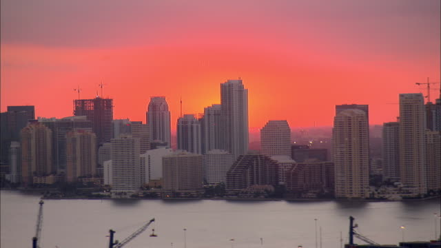 A red sky glows over downtown Miami.