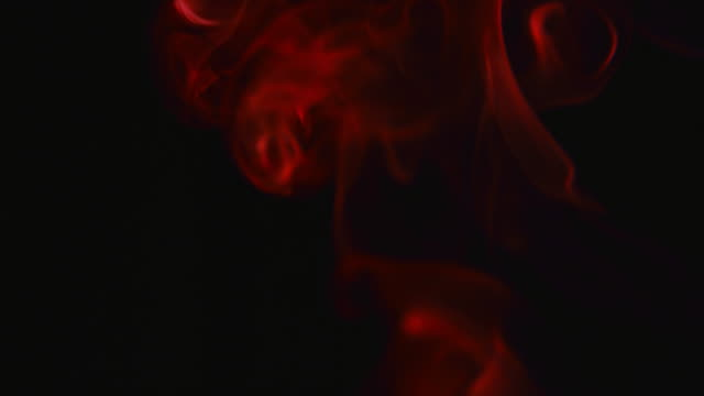 red smoke on a black background stock footage video