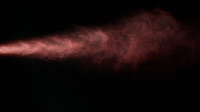 SLO MO red spray paint on black background