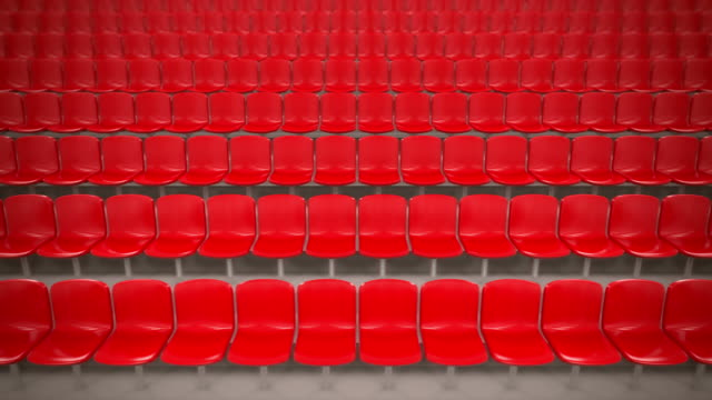 Red stadium seats in a row. Loopable.