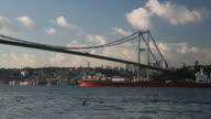 Red Tanker is Passing Under The Bosphorus Bridge