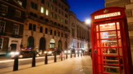 4K Red Telephone Booth at nigh, London, UK time lapse