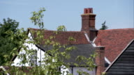 Red tiles roof a Tudor farmhouse in Essex. Available in HD.
