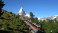 Red train under the Matterhorn