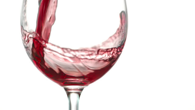 SLO MO of red wine being poured into a glass