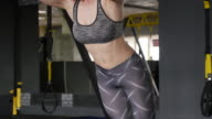 Redhead fitness woman training with trx fitness straps