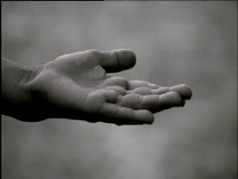 Re-enactment of young Indian girl begging with outstretched hand during Bengali famine of 1770