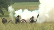 Reenactors demonstrate firing a cannon on Civil War Battlefield Gettysburg National Military Park on June 14 2008 in Gettysburg Pennsylvania