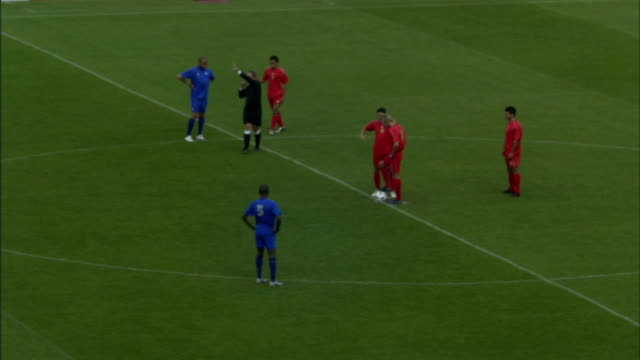 HA WS Referee blowing whistle to put ball in play during soccer game/ Players running and kicking ball/ Sheffield, England