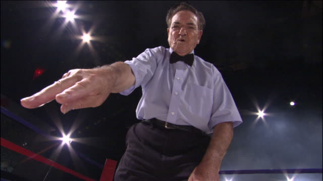 LA POV MS Referee counting down after knockout in boxing ring / Jacksonville, Florida, USA