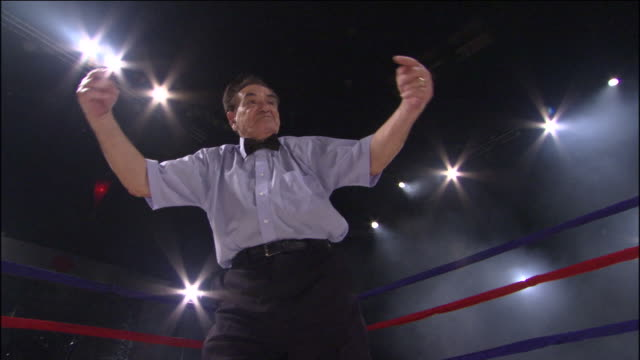 LA MS TD Referee gesturing at start of fight, then two boxers fight in ring / Jacksonville, Florida, USA
