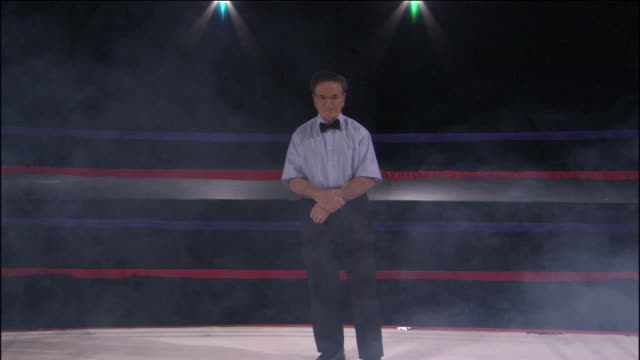 WS Referee standing in boxing ring while smoke rises around him / Jacksonville, Florida, USA