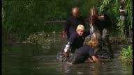 Boris Johnson backs campaign to leave EU T04060910 / Lewisham Boris Johnson falls over in river as helping volunteers clear debris from river...