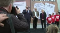 Jeremy Corbyn Tom Watson and Angela Eagle at 'Labour In For Britain' poster launch Tom Watson MP singing song 'Holding Back The Years' on stage SOT