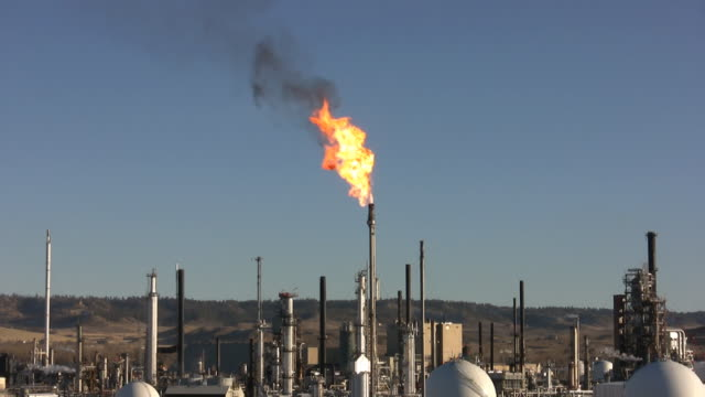 refinery with burn off flame