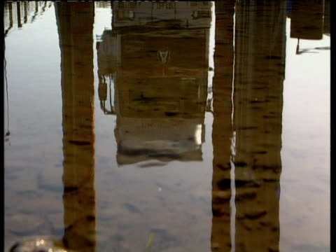 Reflection of Heavy Goods Vehicle in puddle of water