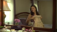 MS, Reflection of teenage girl (16-17) standing in front of mirror, trying on prom dress, Edison, New Jersey, USA
