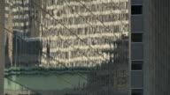 CU LA TU Reflections in skyscraper / New York City, USA