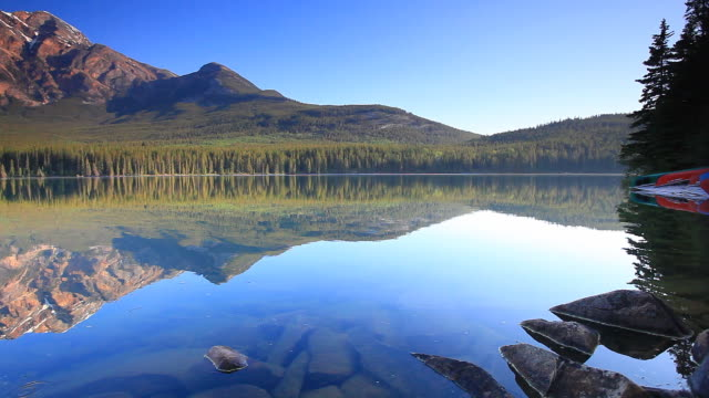 Reflections of Mountains and Canoes in Lake