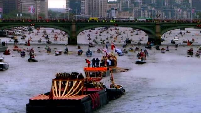 Boats along River Thames during Diamond Jubilee Pageant as rain falling Queen Elizabeth II Prince Philip Duke of Edinburgh Prince Charles Prince of...