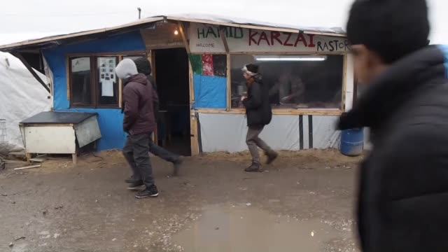 Refugees are seen at the camp known as the 'Wild Jungle' on February 23 2015 in Calais France as evacuation deadline comes close to an end French...