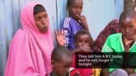 Refugees flock to the Dadaab refugee camp to escape war and famine Now 6yearold Minhaj being examined Withered right arm of Minhaj Dr Said Munwwar...