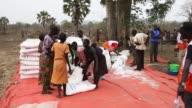 Refugees queue at a World Food Programme food distribution site at a refugee settlement on February 25 2017 in Palorinya Uganda After registering...