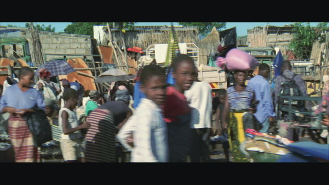 WS POV Refugees selling their wares in refugee camp