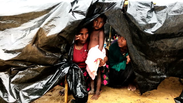 Refugees shelter from a downpour as the monsoon rains create massive challenges for the displac Rohingya September 17 2017 in Kutupalong Cox's Bazar...