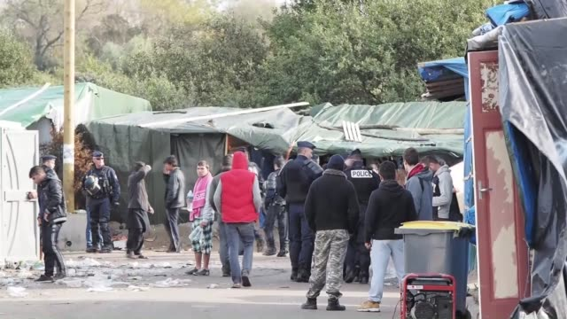Refugees trying to reach the UK shelter at a refugee camp also known as the Jungle in the northern port city of Calais France on October 26 2015...