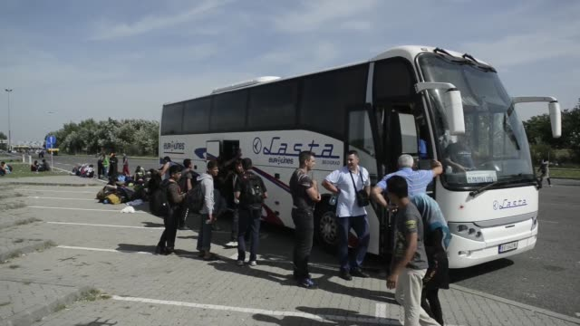 Refugees wait to board buses bound for the Croatian border at the border crossing point in Horgos/Roszke on the Serbian side in Kanjiza Serbia on...