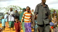 Refugees walking at refugee camp on July 30 2011 in Dadaab Kenya