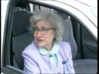 `R' registration cars All ITN copyright Bedfordshire Dunstable Hartwell Ford garage Maureen Borbone into new car in showroom turns key LA CBV R reg...