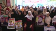 Relatives and family members of Israeliheld Palestinian prisoners stage a demonstration to demand their release from Israeli detention in front of...