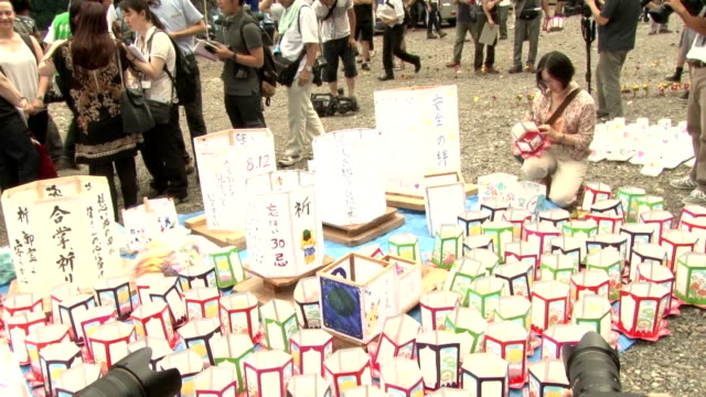 Relatives floated paper lanterns on a river near the site of a 1985 Japan Airlines jet crash and prayed for loved ones and transport safety on...
