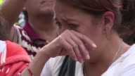 Relatives friends and neighbours laid flowers Thursday in memory of the children who were killed when a 71 magnitude quake toppled an elementary...