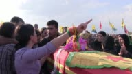 Relatives mourn during the funeral for a Kurdish People's Protection Unit fighters killed during clashes against Islamic State ISIS or ISIL in Al...