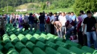 Relatives of 127 people who died during the Srebrenica Massacre mourn at Potocari Memorial Center in Patocari Bosnia and Herzegovina on July 10 2016...