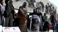 Relatives of people who were murdered in Daesh attack on Spyker military base in Tikrit in last year's June stage demonstration for the 700 Spyker...