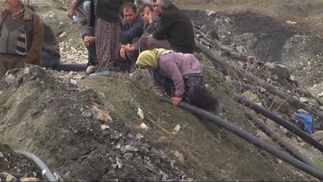 Relatives of Tezcan Gokce one of the 18 miners trapped inside a coal mine flooded with water wait as search and rescue team work in Ermenek district...