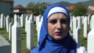 Relatives of the victims pray at cemetery during the 23th anniversary of Ahmici massacre in Vitez Bosnia and Herzegovina on April 16 2014 In Ahmici...