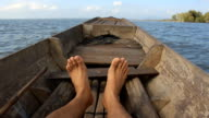 Relaxed tourist moving feet playfully during a boat ride