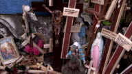 Religious artifacts are arranged together at the Hill of Crosses. Available in HD.