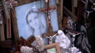Religious artifacts including crucifixes and a painting of the Virgin Mary at the Hill of Crosses. Available in HD.