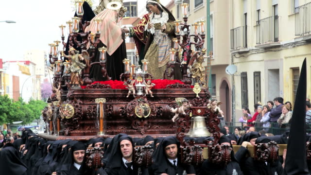 Religious Trono being carried by the Costaleros in a procession in Holy week, Semana Santa, Malaga, Andalucia, Spain, Europe