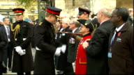 Remembrance Day Prince Harry visits Field of Remembrance ENGLAND London Westminster Abbey POOL EXT Prince Harry in ceremonial military dress chatting...